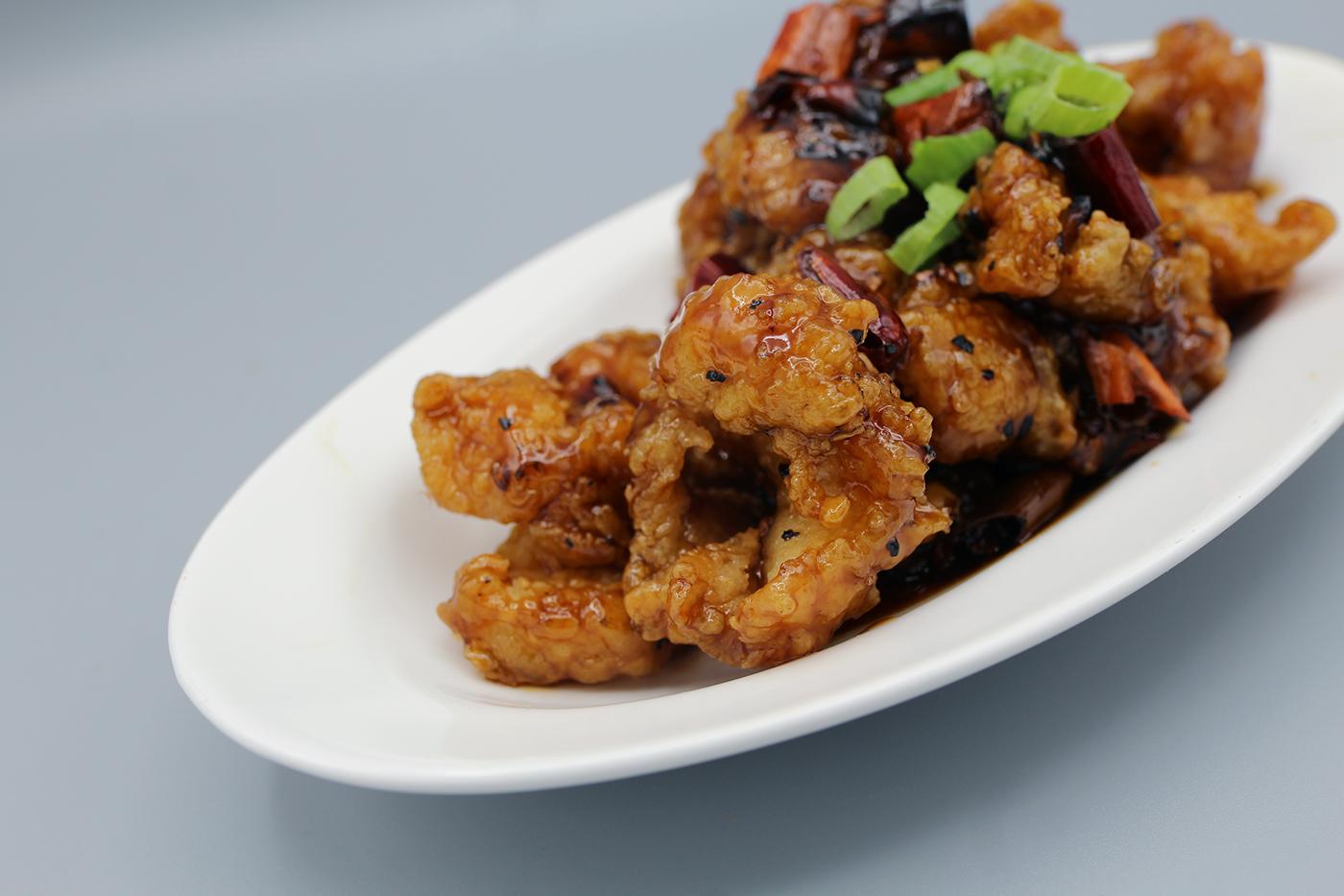 The Pots Spicy Honey-Glazed Fish dish