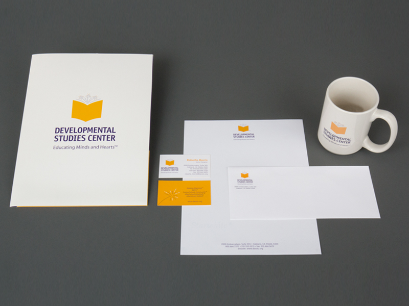 identity package showing pocket folder, letterhead package and mug